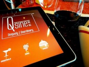 Menu sous forme de tablette numérique au restaurant Qsine